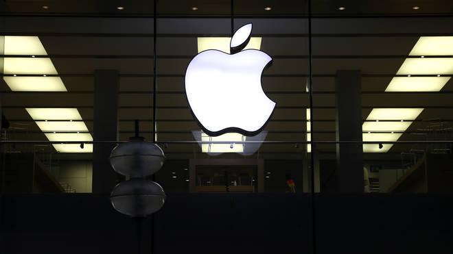 An illuminated Apple logo
