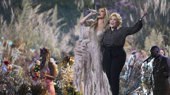 Jennifer Lopez performs with her mother, Guadalupe Rodriguez, at Vax Live: The Concert To Reunite The World at SoFi Stadium in Inglewood, California