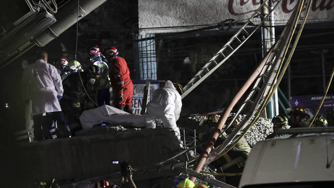 A rescue mission is underway to lift people out of the rubble