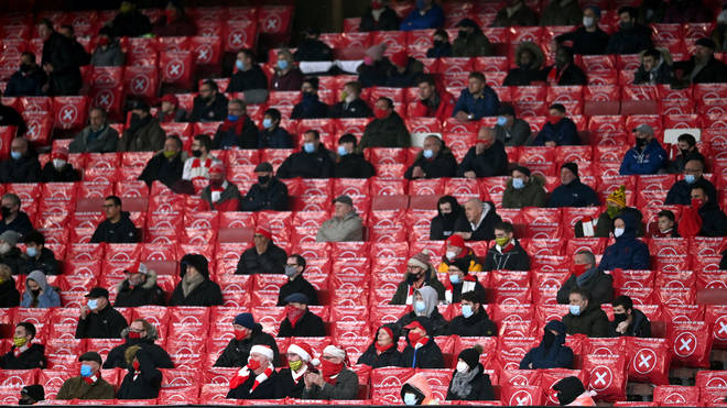 Socially distanced Arsenal fans watch their team play in December