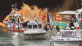 Dozens of French fishing boats protested off the coast of Jersey on Thursday