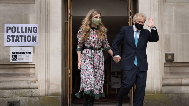 Boris Johnson and Carrie Symonds leave after casting their vote