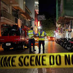 Maldivian police officers stand behind police tape
