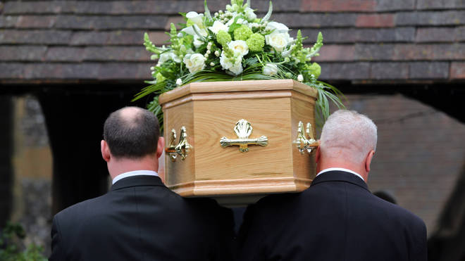 A coffin being carried