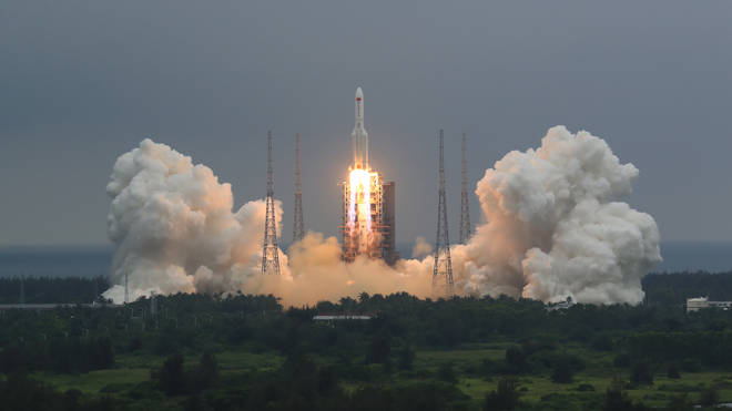 China says the central rocket segment that launched the 22.5-ton core of China's newest space station into orbit burned up as it re-entered Earth's atmosphere early on Sunday