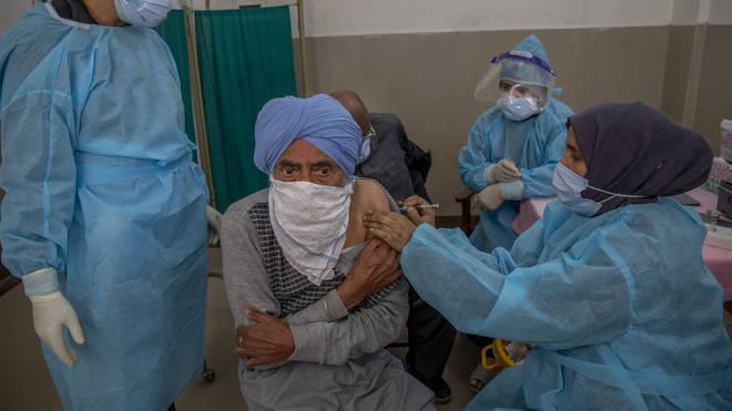 A Kashmiri man receives a vaccine for Covid-19