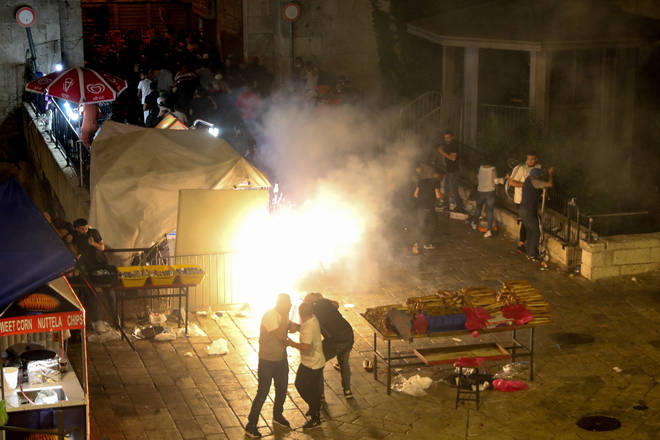 A stun grenade explodes during clashes amid tension outside the Damascus Gate of Jerusalem's Old City.