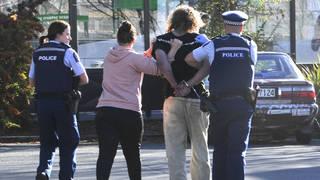 Police take a suspect into custody