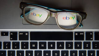 The logo of internet auction site eBay reflected in a pair of glasses