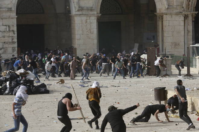 Palestinians clash with Israeli security forces at the Al Aqsa Mosque compound