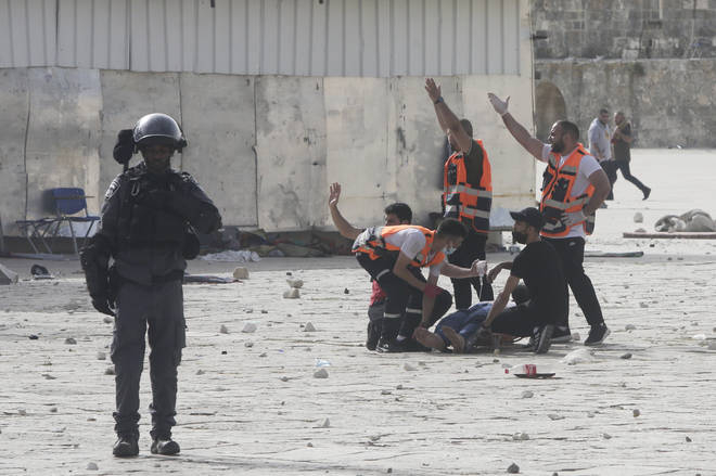 Medics treat a wounded man during clashes
