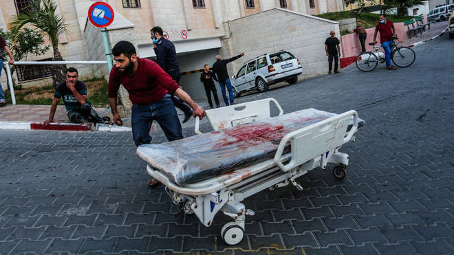 Palestinians rushed to assist those injured by the air strikes on Tuesday morning