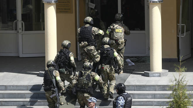 Armed police attend the scene of a school shooting in Russia