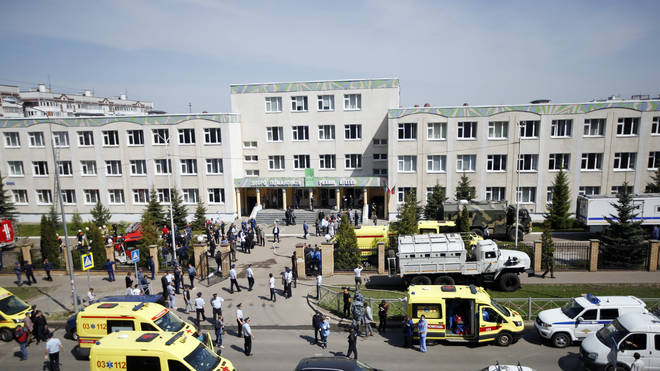Ambulances and police cars at a school after a shooting in Kazan, Russia