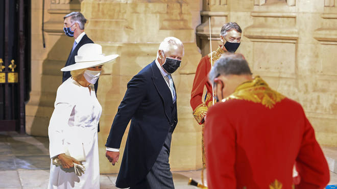 Her Majesty was accompanied by her son the Prince of Wales and his wife the Duchess of Cornwall, who each wore facemasks