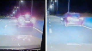 The police dashcam footage shows officers attempting to pull the driver over