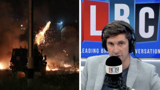Reporter dons bullet proof clothes live on air as stun grenades explode in Israel