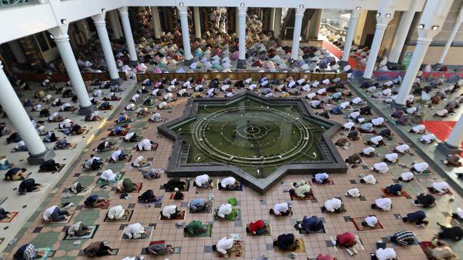 Muslims pray spaced apart to help curb the spread of coronavirus outbreak during an Eid al-Fitr prayer marking the end of Ramadan at Al Akbar mosque in Surabaya, East Java