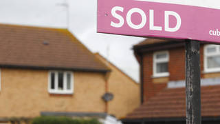Houses with a sold sign