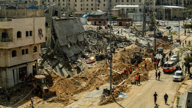 The wreckage of a large apartment complex by the ongoing Israeli airstrikes in Beit Lahia, Gaza