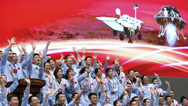 Members at the Beijing Aerospace Control Centre celebrate