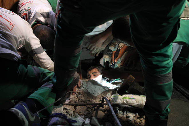 Rescuers are racing to pull people from the rubble in Gaza after Israeli air strikes.