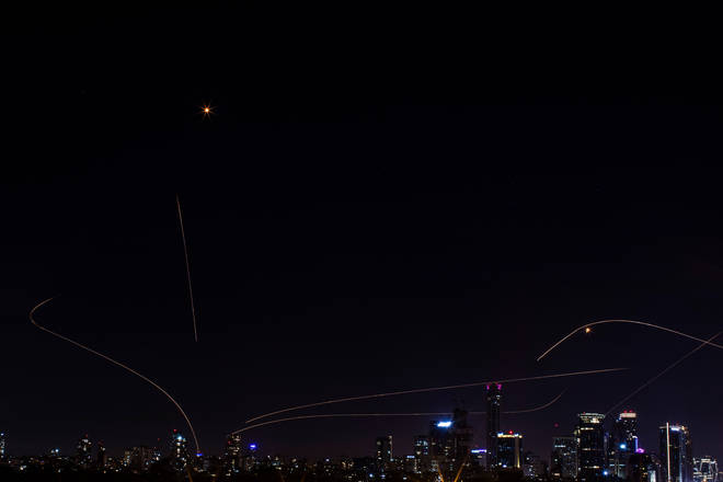 Israeli Iron Dome missiles intercept rockets fired from the Gaza Strip towards Israel.