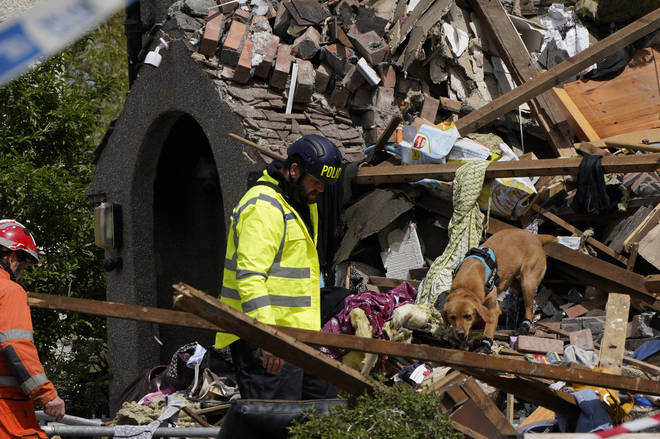 Emergency workers picked through the rubble with sniffer dogs on Sunday morning.