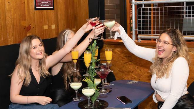 Locals enjoy an indoor drink at Showtime Bar in Huddersfield