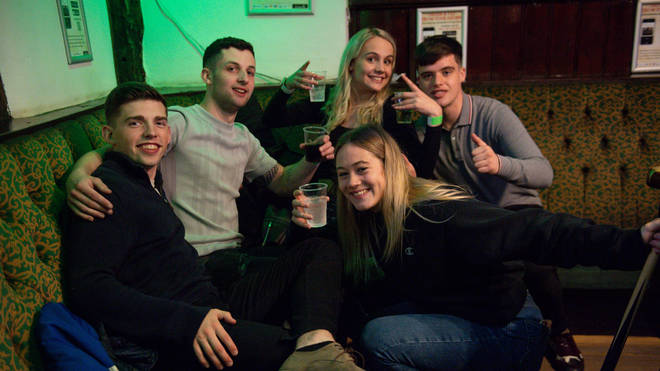 A group pose for a photo inside a pub in Coventry