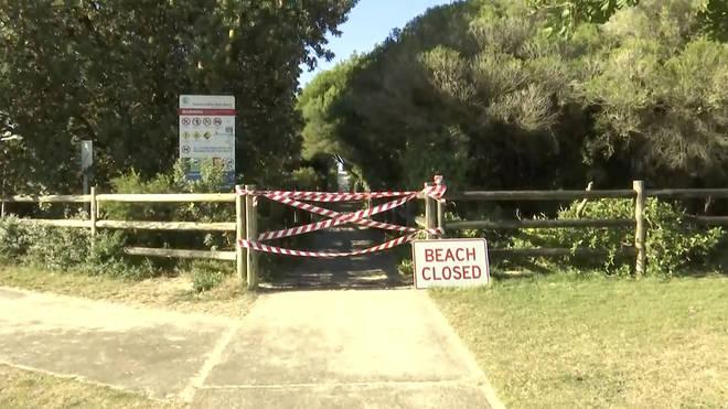 A beach closed sign in Tuncurry, Australia