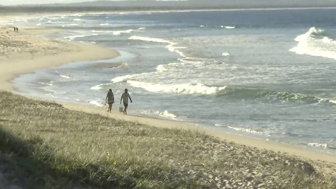 Image from a video shot on a nearby beach to where the man was attacked by a shark