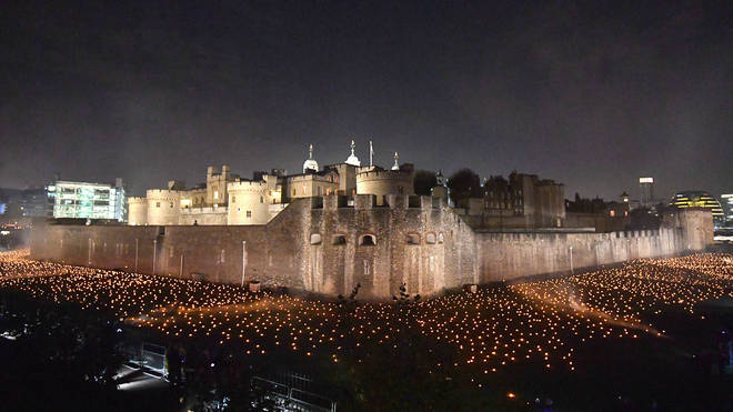 Thousands Of Flames In The Dry Moat Of The Tower Of London As Part Of An Installation Called Beyond the Deepening Shadow