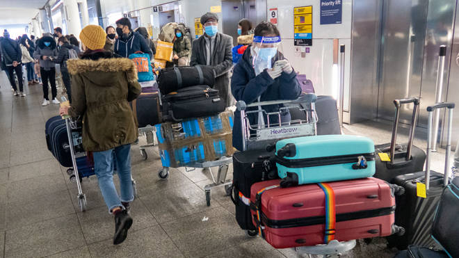 Passengers queue at Heathrow airport (file image)