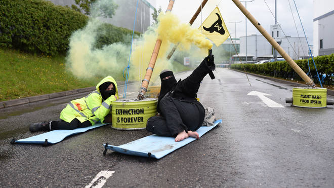 A McDonald's distribution centre has been blocked by Animal Rights protester