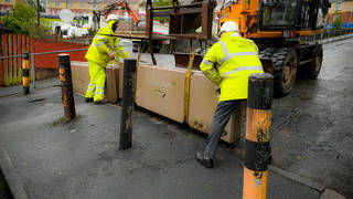 Heavy concrete barriers at the top of Waun Wen Road, Swansea, where large-scale disorder broke out on Thursday