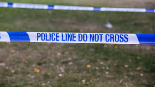 A police officer has been kicked out of Surrey Police after beating his partner