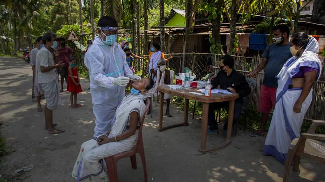 Health worker takes Covid-19 swab