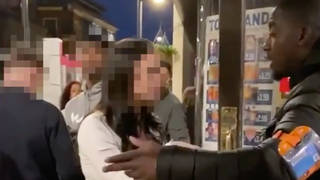 A video of a woman racially abusing a doorman in Birmingham has gone viral