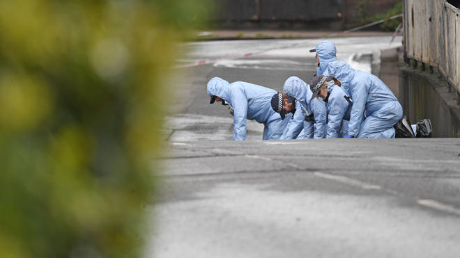 Forensic officers carry out searches in Peckham after the shooting