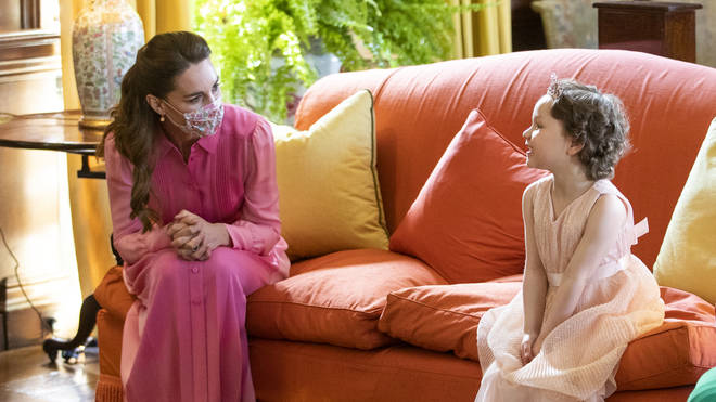 The Duchess of Cambridge kept her promise to the little girl, wearing a pink dress when they met.