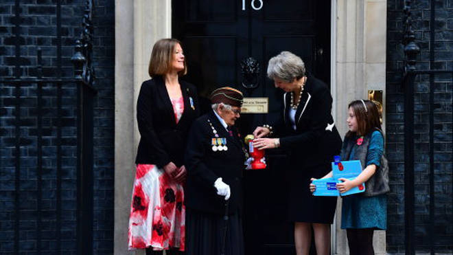 Theresa May and Royal British Legion volunteers
