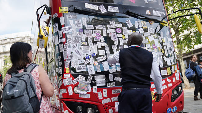 Protesters placed stickers all over the bus near Trafalgar Square