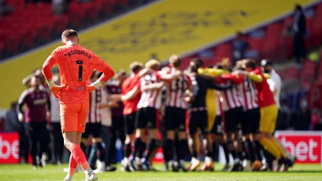 Swansea goalkeeper Freddie Woodman appeared dejected as Brentford celebrated promotion