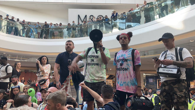 Anti-vaxxers clashed with police but were removed from Westfield shortly after