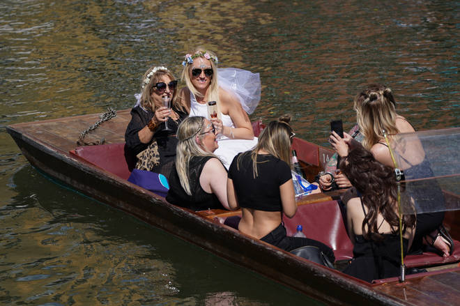 Visitors enjoyed special occasions on punts in Cambridge as the city heated up on Saturday