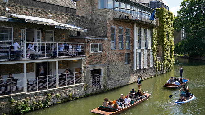 Punts floated past pubs in Cambridge during the bank holiday weekend