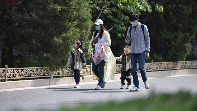 China's ruling Communist Party will ease birth limits to allow all couples to have three children instead of two