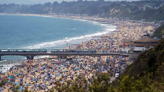Crowds descended on Bournemouth Beach on Sunday, with the Met Office forecasting Bank Holiday Monday will be the hottest day so far this year.