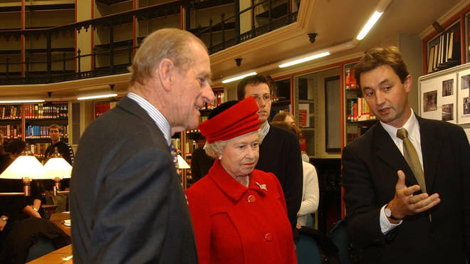 The Queen and Prince Philip visiting the Maughan Library at King's College London in 2002.